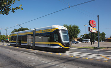 Dallas Streetcar passes by El Fenix in Oak Cliff