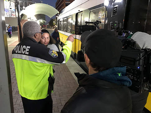 Chief James Spiller talks with a DART customer at West End Station on Mar. 7