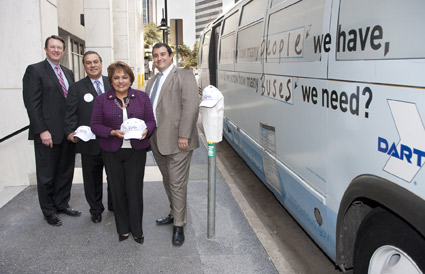 DART President/Executive Director Gary Thomas, DART Board Chairman Bill Velasco, Dallas Deputy Mayor Pro Tem Pauline Medrano and Regional Census Director Gabriel Sanchez stand before one of eight specially wrapped DART buses showcasing information concerning Census 2010.