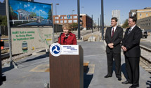 Image: DOT Secretary Mary Peters speaking at Deep Ellum Station on October 24 with DART Board Chairman Randall Chrisman (left) and DART President/Executive Director Gary Thomas