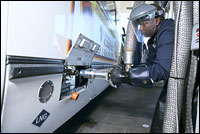Image of an operator fueling a DART LNG bus