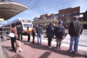 Riders boarding a train at the Downtown Plano Station