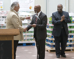 Image: Victor Burke, DART Executive Vice President of Operations, presents a check and 15 tons of donated food from transit employees to Bill Thompson, Union Gospel Mission Executive Director. Looking on is DART employee and event chairman David Perry.