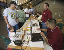 Image of Hurricane Katrina evacuees with DART personnel at Reunion Arena
