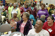 Seniors sing 'God Bless America' during DART's 10th Annual Older Americans Health and Information Fair.