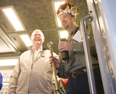 Image: Wayne Friesner, CEO of the Trinity Railway Express rides an early morning train with Tim Clark of Bedford, the 20 millionth customer of the 12-year old commuter line between Dallas and Fort Worth.