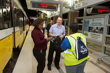 DART staff greet riders at UNT Dallas Station on the first day of service, Monday, October 24