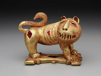 Sword ornament in the form of a lion, Asante peoples, Nsuta, Ghana, Africa, c. mid–20th century, cast gold and felt, Dallas Museum of Art, The Eugene and Margaret McDermott Art Fund, Inc. 2010.2.McD