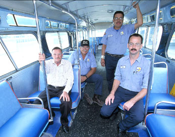 (L to R) DART Mechanics Billy England, Ismael Serrano, Carlos 'CD' Warren and John Trojacek worked during their free time for two years to restore the hard-to-find 1966 General Motors New Look Dallas Transit System (DTS) bus -- that seats 53 -- to its original state. In an effort to preserve DTS and DART history, the mechanics recycled parts from another 1966 bus as well as those acquired from bus vendors.
