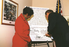 US Rep. Eddie Bernice Johnson (TX-30) looks on as DART President/Executive Director Roger Snoble signs a $333 million Full Funding Grant Agreement for the extension of DART's North Central light rail line.
