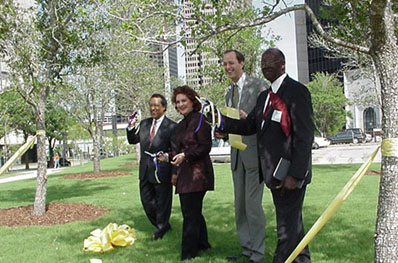 Jesse Oliver, Veletta Forsythe Lill, Lee Waddleton and Martin Cox at the Pearl Street Connector ribbon cutting ceremony.